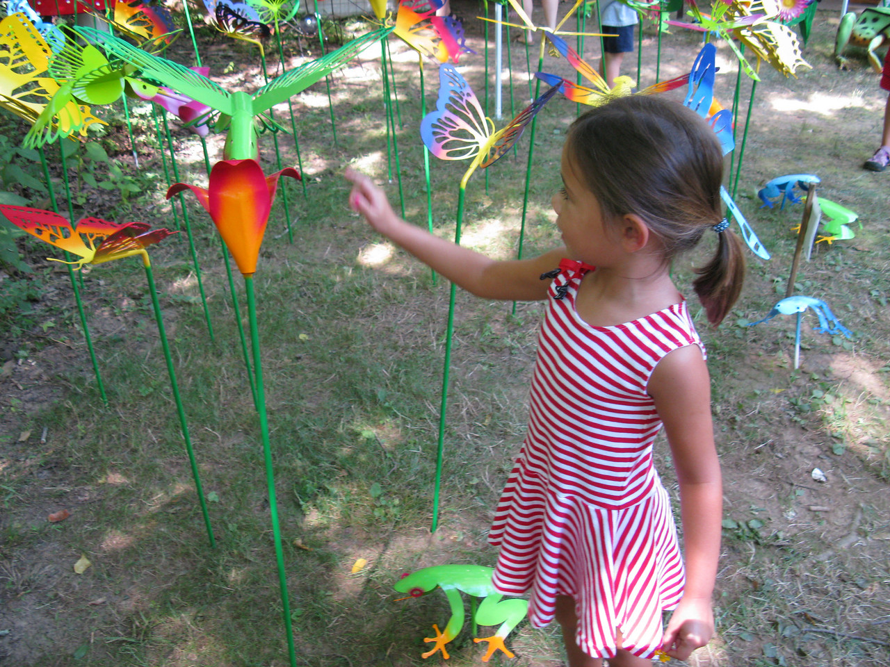 Anna's looking up to these beautiful butterflies.<br /> July 4, 2009