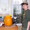 Patti shows her jack-o-lantern to Simon.  Halloween 2004