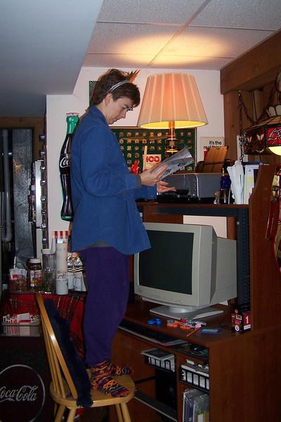 Patti and Jeane begin to install Sandi's new printer.