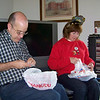 "Laura and Lane dig through their ""stocking"" stuffers.  Christmas 2009"