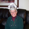 Jeane shows off the hat Linda got her to wear on the upcoming New Year's celebration.  Christmas 2009
