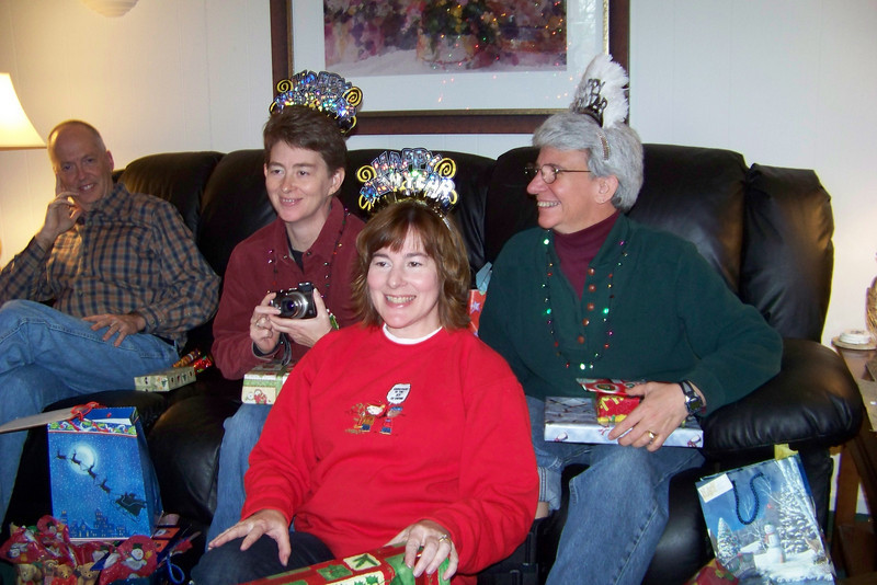 Patti, Laura, and Jeane all model their New Year's tiaras.  Christmas 2009