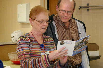 Fran and Tony read a gift card. Fran's retirement party; 11/30/2012