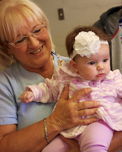 Sharon, holding Jennifer's baby, Scarlet; Sharon's retirement party, 10/20/11