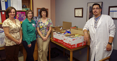 Lea Patton, Mary Richards, Teri Ingram and Jaime Jimenez, Cox North laboratory, with Shoebox for Soldiers items.