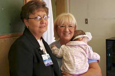 Sue and Sharon, holding baby Scarlet; Sharon's retirement party, lab, 10/20/11