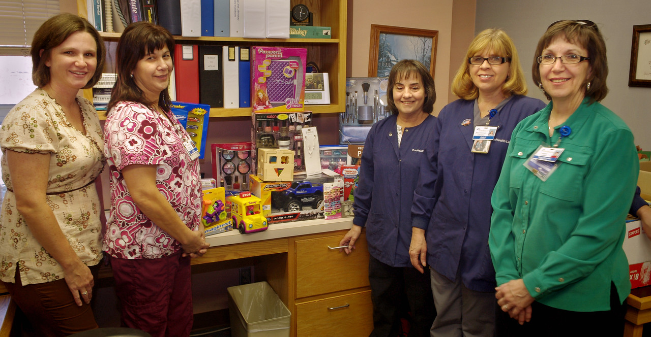 """North Laboratory Christmas project. From left: Lea Patton, Angela Boger, Debby Ford, Darla Lowrance, and Mary Richards with toys gathered for the West Central neighborhood """"Free Store""""."""