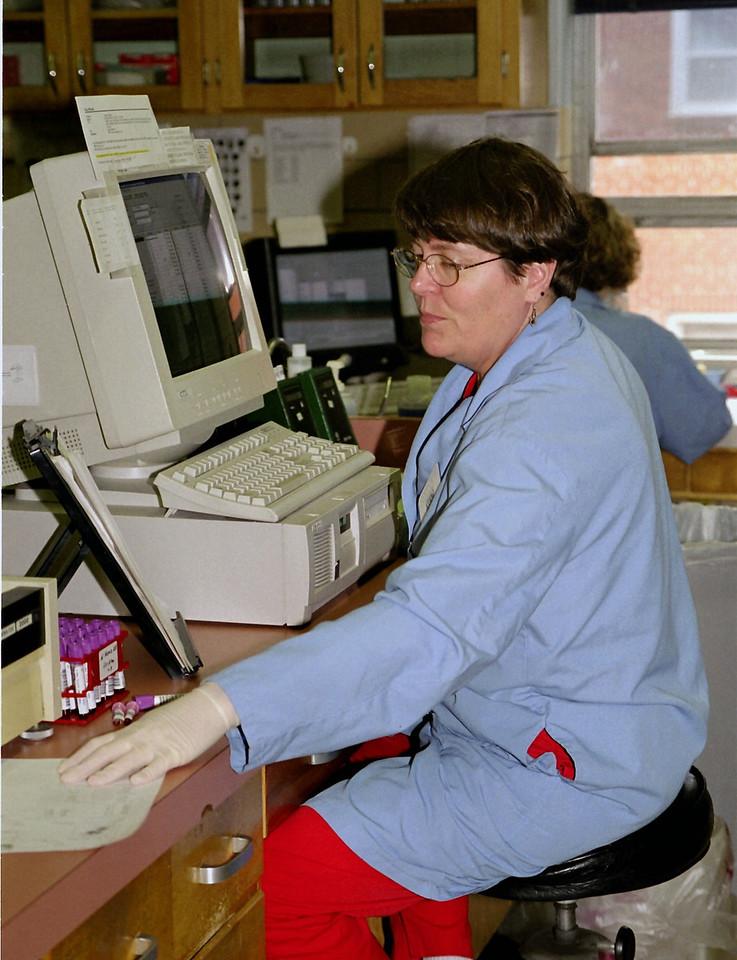Kay, doing hematology bench work.