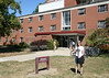 Dakota in front of her new dorm, Barrows Hall