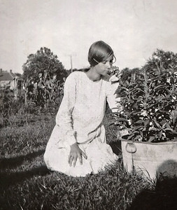 "Doris Doss in the flower garden. Back of photo is marked: ""Doris"""