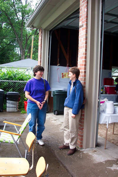 Patti chats with Lisa Freeman at a Pride of Kentucky and friends barbecue.