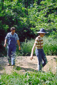 Gerald and Tim on some sort of an adventure near an Ozarks creek. July 1979.