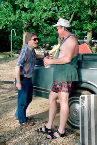 Jim and Tim shooting the breeze by Stockton Lake. No Gotta Yachta Regatta, May 1994.