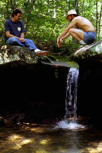 Gerald and Rick cooling off near a waterfall on Ricks property near Twin Bridges. June 1985
