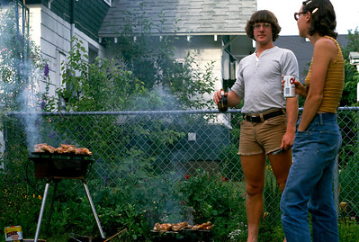 Mark McNay and Rita around the barbecue grill in Gary and Rita's back yard, Spokane Washington - 1978