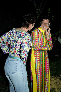 Katie and Rita laughing it up at Abbe's retro birthday party, April 2000