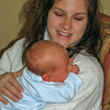 Henry at 18 days old, with Becca