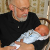 Henry at 18 days old, with Grandpa