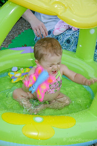 Isabella in Pool, 8-1/2 months - water slaps back