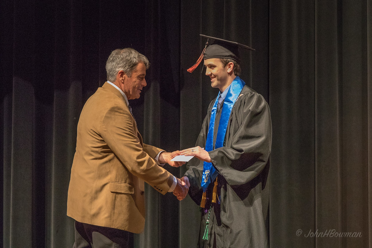 Mac - Receiving Scholarship from Mr. Watts