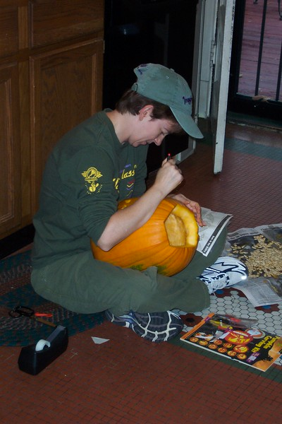 Halloween 2004 - after disemboweling the pumpkin, Patti sets to work.