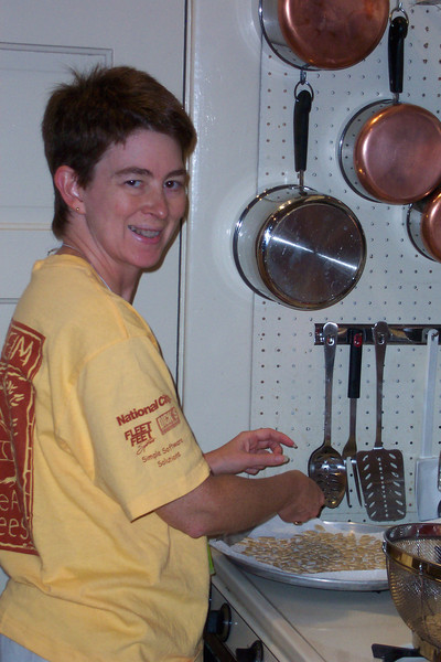 Patti, having carved our Halloween pumpkin, prepares to dry the seeds for the birds this winter.  They are a popular taste sensation with the neighborhood wildlife.  October 2003