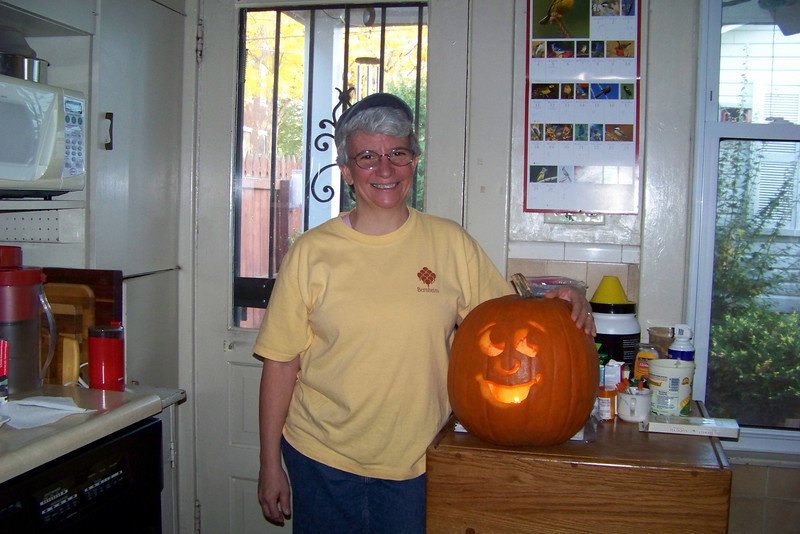Jeane carves the Halloween pumpkin this year, since Patti is not in the mood and overwhelmed with stuff to do.  Halloween 2009.