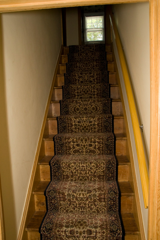 Steps going upstairs to 2nd floor.  Carpet is secure and in good shape