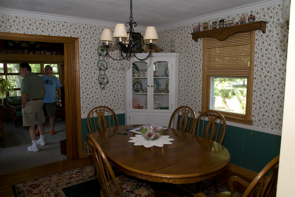 Dining room.  Wallpaper has to go.  The corner unit is staying so we finally have a place for our china!