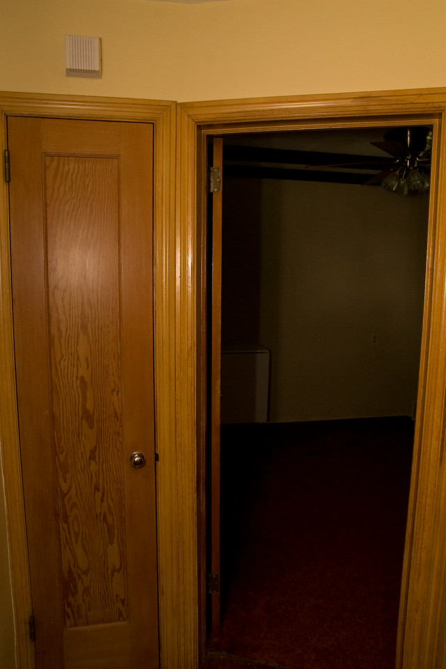 hallway on main level looking into 4th bedroom/office and a linen closet