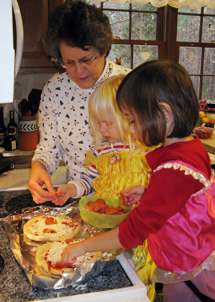 Chefs Anna and Lilja make lunch. S,S, & J, do you remember pizza night?