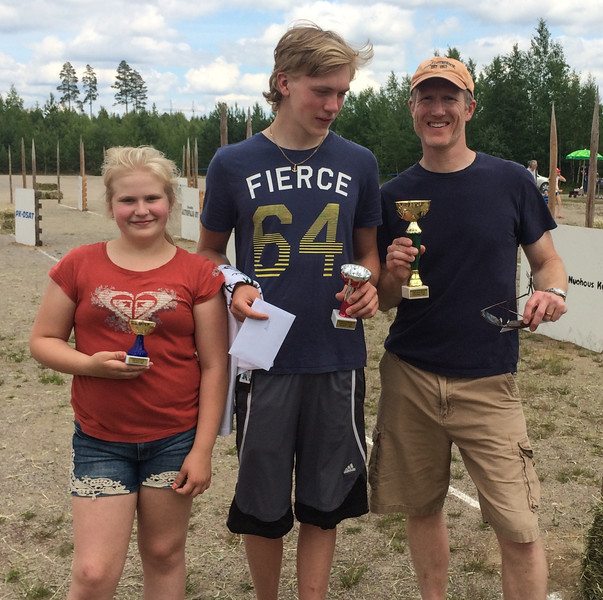 Jay and Toren took firsts. Toren is distressed that his trophy isn't as large. Lilja took 2nd in her first race.