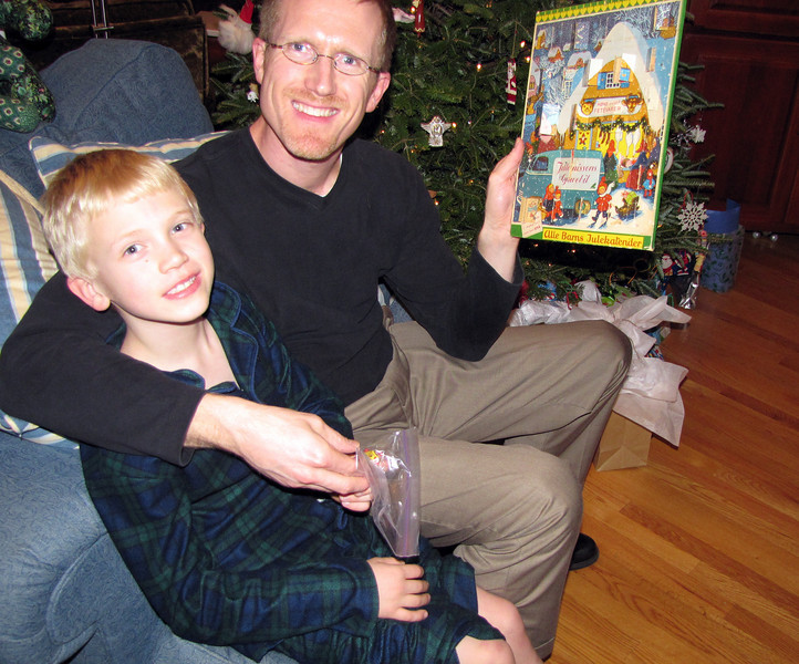 Jay and Toren enjoy the Advent calendar the Thompson children used when they were young. Each day is labeled with initials. Who got to do the first one? the last? What a great family memory!