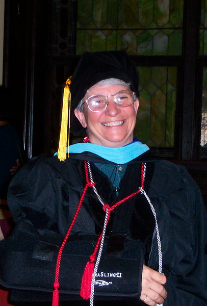 Jeane's ability to dress herself in cap and gown was limited by her splint (rotator cuff surgery), but she pulled it off with a lot of help.