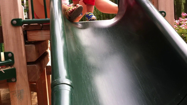 Luca loves the slide, especially going down face first.