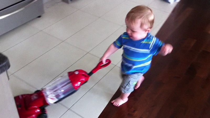 We found a toy replica of our vacuum which Luca loves to play with. Here he is helping to vacuum the apartment.