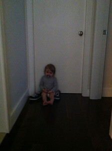 Luca brought Erin's shoes to the door and sat there waiting for her to wake-up Sunday morning.