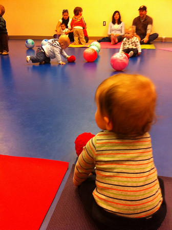 Luca in music class.  He is sitting on his own more and more!