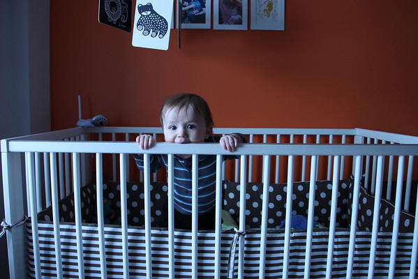 this is how we find him now in his crib....standing waiting for us to come in!