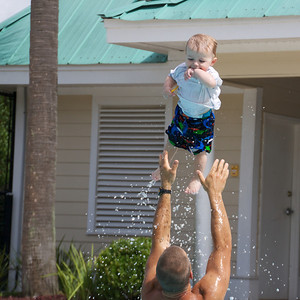 Catching some air in the pool with Uncle Craig.