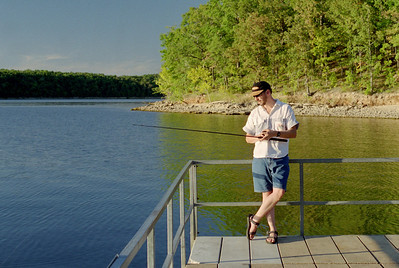 Randy fishing from the boat dock; Lake of the Ozarks. October, 2000.
