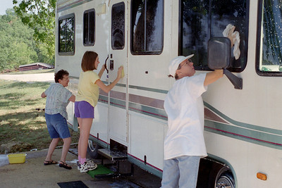Lela, Cecilia and Rita washing Lela and Floyd's RV; Lake of the Ozarks. October, 2000.