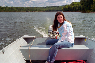 Cecilia running the motor boat, Lake Ozark, MO - Aug. 2004