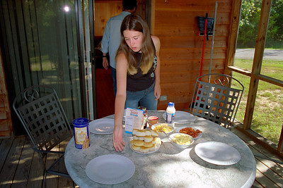 Cecilia setting the breakfast table. Lake Ozark, Aug. 2004