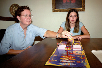 Rita and Cecilia playing a board game at Lela and Floyd's, Aug. 2004