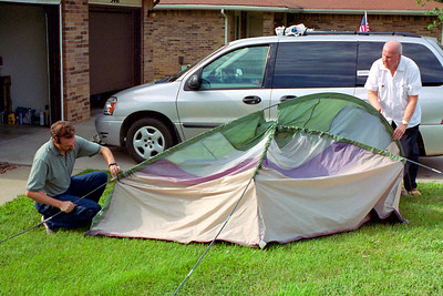 Randy and Floyd putting up the tent in Floyd's yard, Aug. 2004