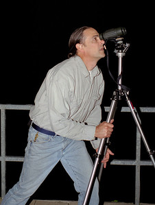 Gary looking at the full moon with binoculars, Lake of the Ozarks, October, 2000.