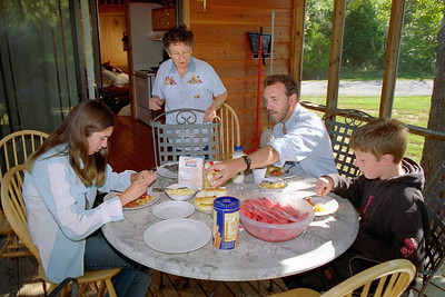 Cecilia, Lela, Randy and Bobby around the breakfast table at Lake Ozark, Aug. 2004