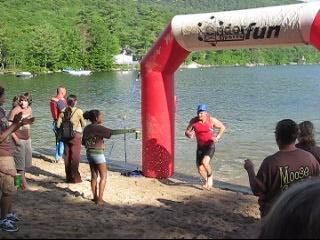 Craig finishing the swim, running to the bike transition
