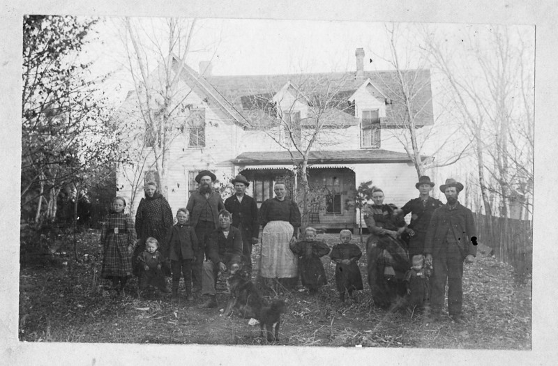 Lucy, Ida with Ella in front of her, August, Grandpa Fisher, Henry, the hired man, Grandman Fischer holding Doras hand, Clara, Grandma Ress holding Pauline,  with Guss Ress holding Ellas hand,Ernest Ress